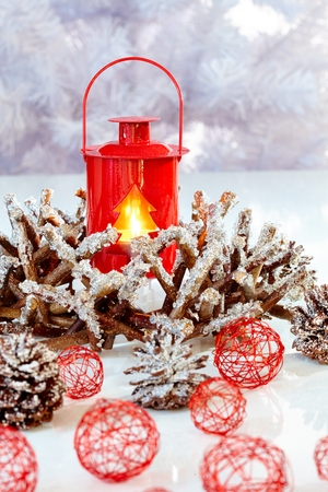 stilllife: Christmas still-life with snowy ornaments and night-light. Stock Photo