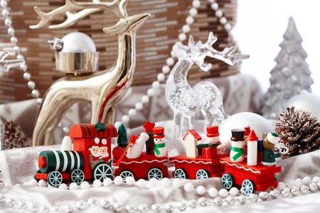 stockphoto: Lovely christmas decoration with small red train and pastel ornaments.