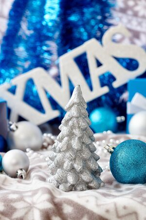 stilllife: Christmas still-life in blue with ornaments and pine tree.