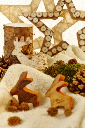 pineal: Closeup photo of natural christmas decoration with stars, reindeer and pineal.