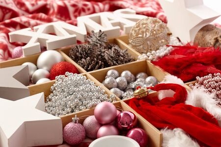 stockphoto: Christmas ornaments in a wooden compartment with letters xmas.