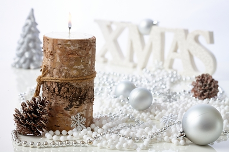 stilllife: Natural christmas still-life with candle, pineal and ornaments. Stock Photo
