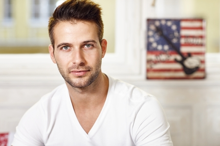 young unshaven: Portrait of handsome young man looking at camera.