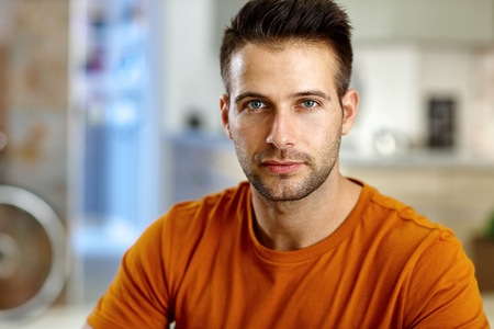 stubbly: Closeup portrait of handsome young man, looking at camera.