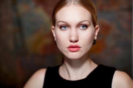 scandinavian people: Closeup portrait of beautiful cold looking woman in makeup. Stock Photo