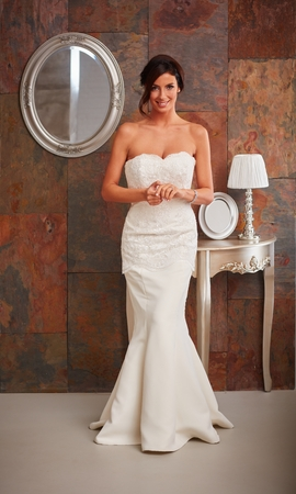 wedding gown: Beautiful bride standing in wedding gown, smiling happy. Full size. Stock Photo