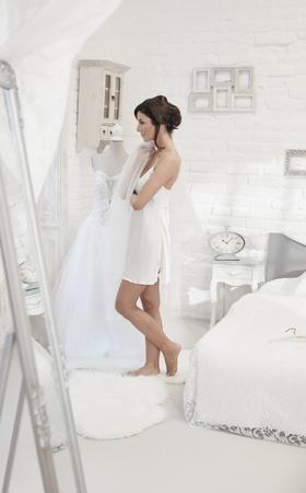 babydoll: Beautiful bride preparing herself on wedding-day.
