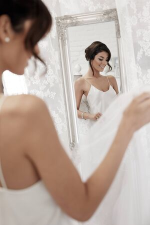 stockphoto: Beautiful young woman preparing herself for wedding-day. Stock Photo