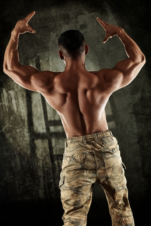 male hair: Male bodybuilder showing perfect back muscles. Stock Photo