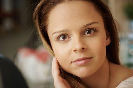 natural looking: Closeup portrait of natural young woman looking at camera. Stock Photo