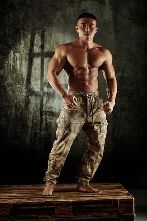 bare chest: Male bodybuilder posing with bare chest in studio.
