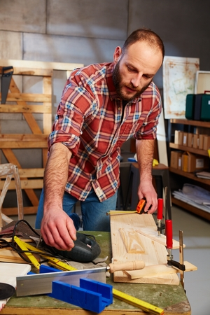tinkering: Busy joiner working in workshop.