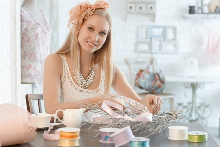 scandinavian people: Beautiful young woman making decoration in retro style.