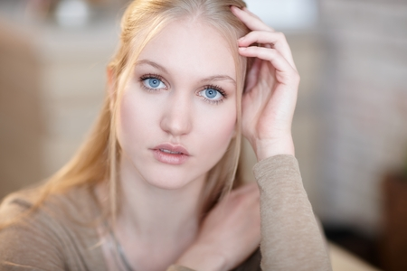 innocent: Portrait of natural beauty nordic woman with innocent blue eyes.