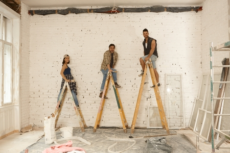 Team photo of painters working on renovation site. photo