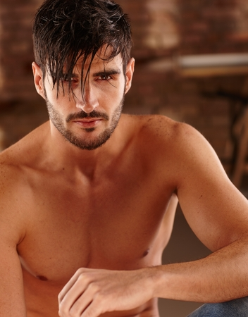 bristly: Closeup photo of goodlooking young man with bare chest. Stock Photo