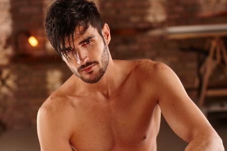 bristly: Portrait of handsome young man with bare chest. Stock Photo