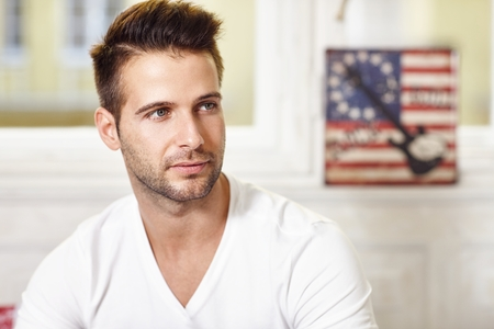 fantasize: Portrait of thoughtful young handsome man looking away. Stock Photo