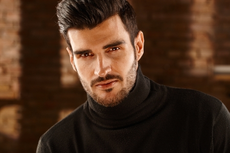 turtleneck: Closeup portrait of handsome young man looking at camera in turtleneck pullover. Stock Photo