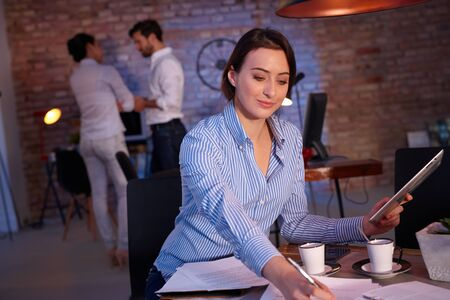 stockphoto: Businesswoman sitting at desk, working in office.