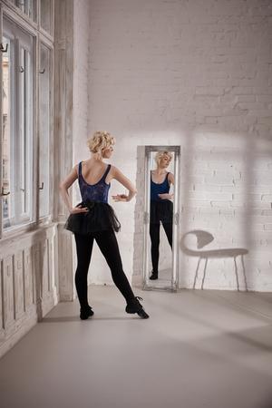 reflection mirror: Ballet dancer training front of mirror in ballet studio.
