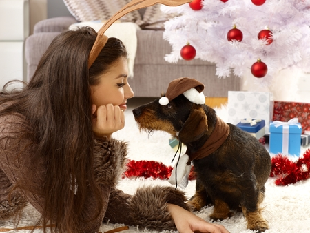 be kissed: Lovely christmas photo of woman and dog in harmony.