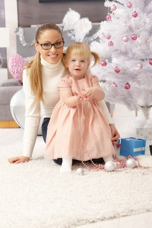Happy mother and little daughter at christmas time. photo