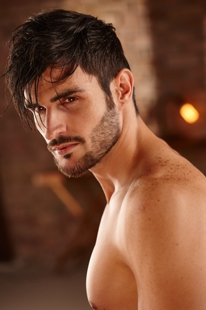 male face: Portrait of handsome charming man with bare chest.