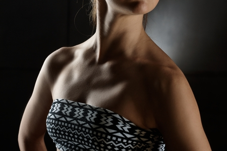 Torso of athletic young woman wearing bras. photo