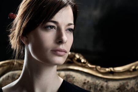 fantasize: Closeup portrait of natural young woman looking away, daydreaming.