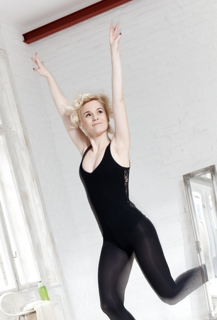 Female dancer enjoying dancing. Motion blur.