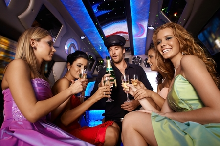 Party fun in limousine with attractive women. photo