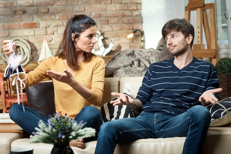 Young woman showing sexy panties to boyfriend as exposure of being false. Stock Photo