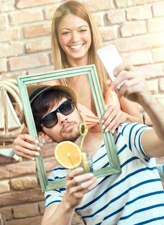 Happy couple making selfie on summer holiday, having fun, laughing. Stock Photo