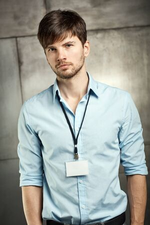 bristly: Portrait of young businessman in shirt, looking at camera. Stock Photo