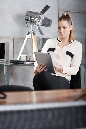 Young businesswoman working with tablet computer. photo
