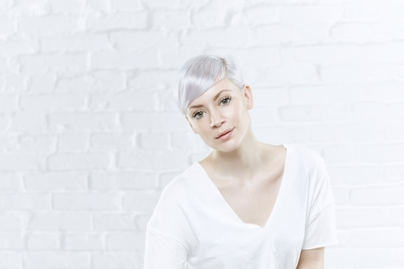 twiggy: Closeup portrait of young woman with short platinum blonde hair. Stock Photo