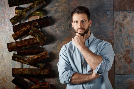 mid thirties: Portrait of handsome bearded man looking at camera with serious facial expression. Stock Photo