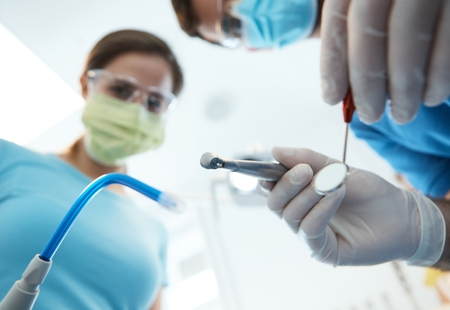 Dental treatment photographed from patient's point of view. photo