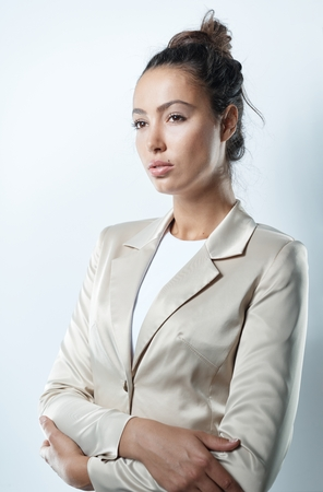 Serious businesswoman standing arms crossed. Stock Photo