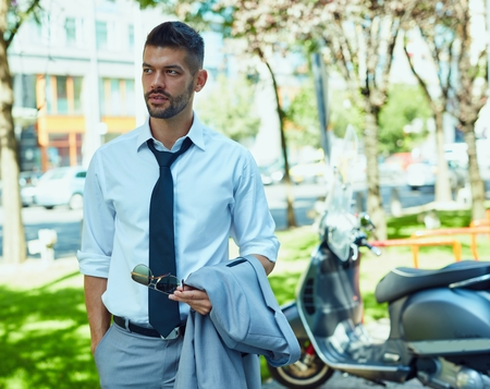 Portrait of businessman on street in urban setting. Young elegant handsome man. Stock Photo