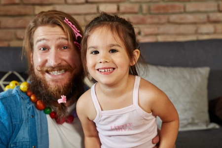 Portrait of happy smiling father and little daughter. Stock Photo