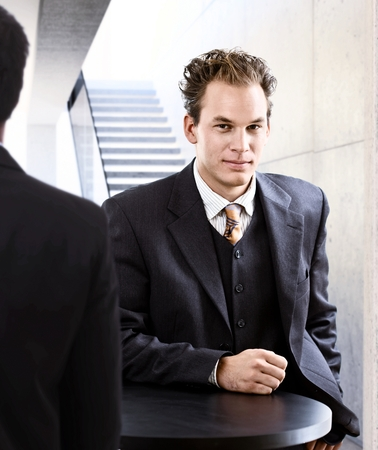 Portrait of elegant young businessman looking at camera. photo