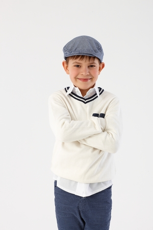 Cool little boy standing arms crossed. photo