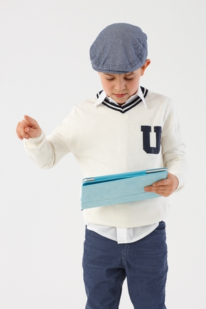 Schoolboy using tablet computer. photo