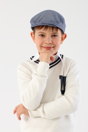Portrait of confident little boy in cool hat looking at camera. photo