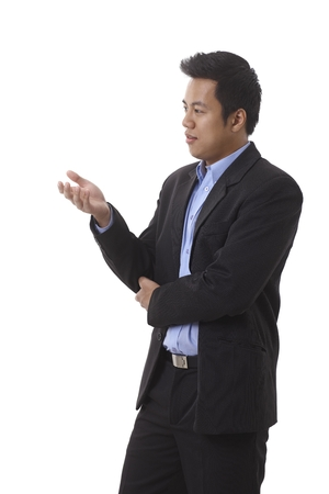 Side view of young Asian businessman, talking, gesturing.