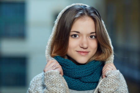 Closeup photo of attractive young woman smiling, looking at camera. Stock Photo