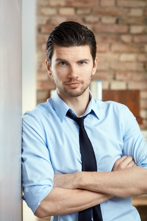 Portrait of confident young businessman looking at camera.
