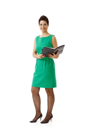 Gelukkige jonge onderneemster in groene die kleding op wit wordt geïsoleerd.% 00